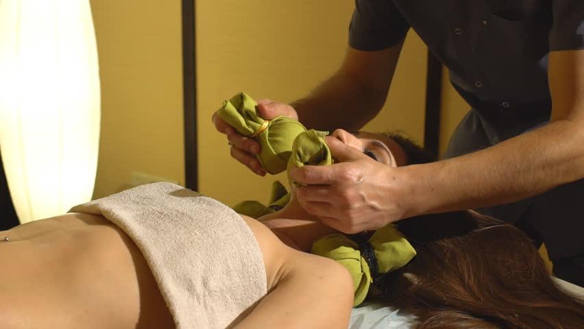 Masseur doing massage on woman body in the spa salon.   Shutterstock HD Video #21990832