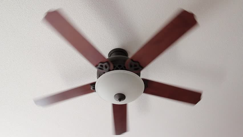 A Ceiling Fan Slowly Spins on Low Setting
