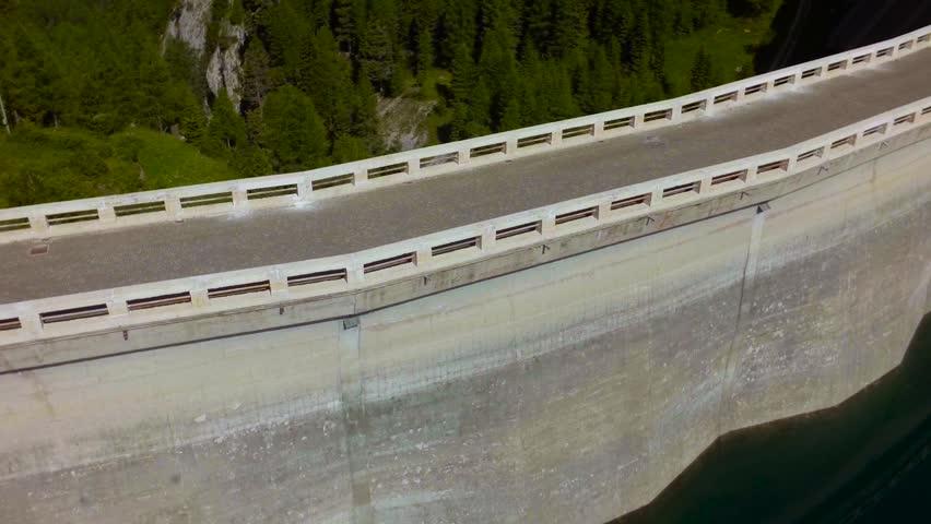 Dam on the mountain lake. Lake Fedaia. Dolomite. Aerial view.