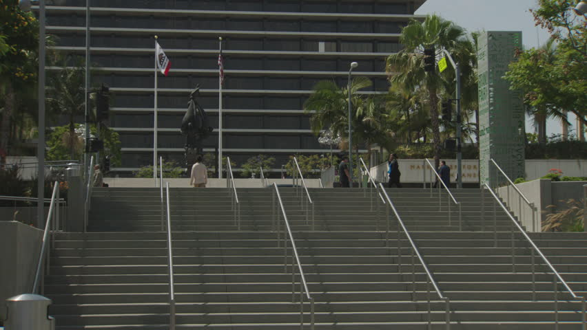 Day looking over steps large government building courthouse downtown civic center, spring summer, palm trees, breezy, see California Flag | Shutterstock HD Video #22026862