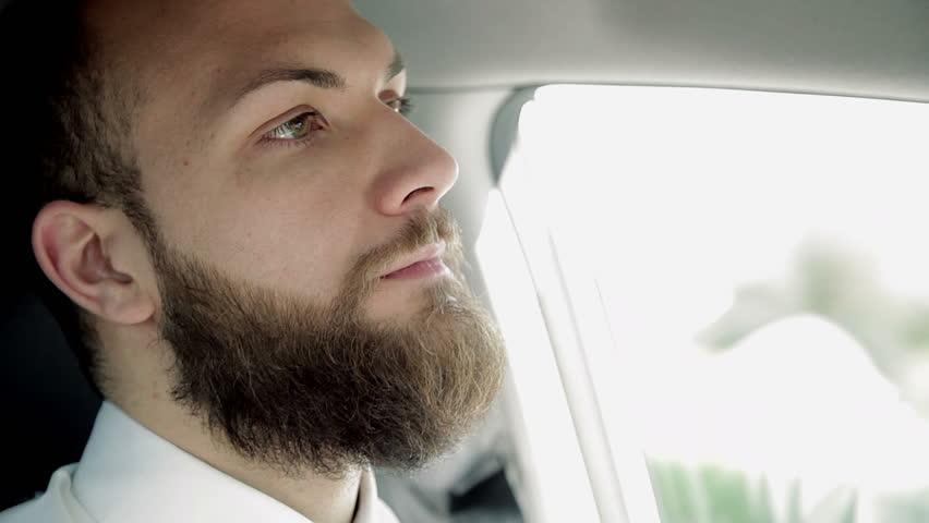 Closeup of serious handsome man driving car feeling sad   Shutterstock HD Video #22092172