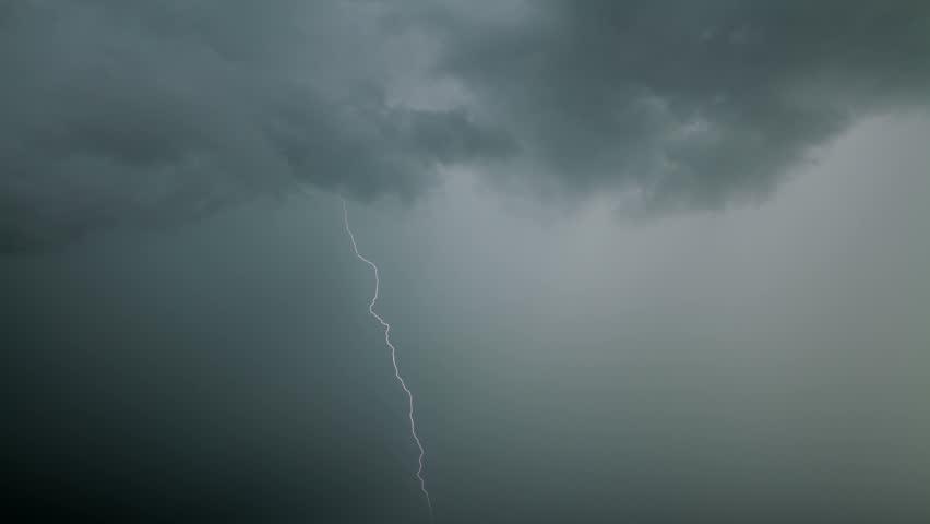 Lightning through heavy rain fog in the day. #2210542