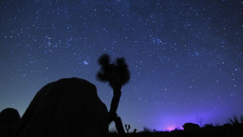 Stars/Galaxy Time lapse over Joshua Tree