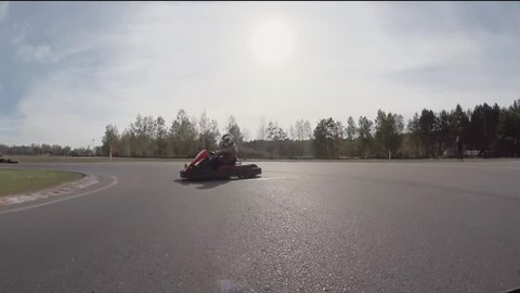 Clash of karting. Camera on a kartmoving and hitting another kart. Go-kart track.