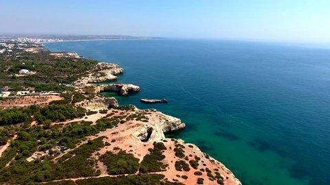 Aerial view of the Algarve Coast between Praia da Marinha beach and  Nossa Senhora da Rocha beach, Algarve south of Portugal