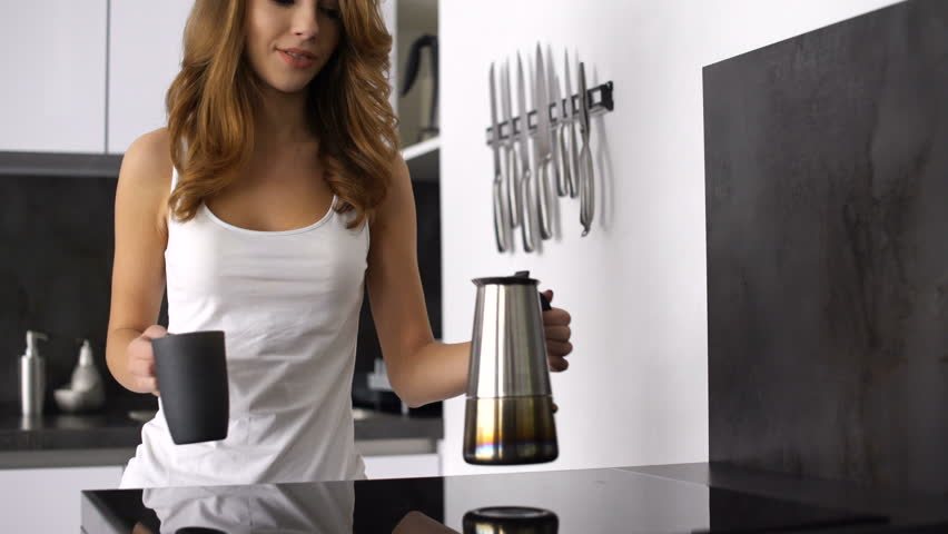 Smiling Young Woman Pouring Herself A Mug Of Hot Filtered Coffee From Maker