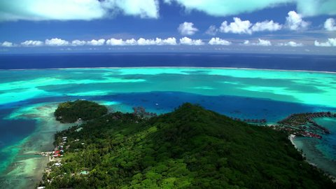 Aerial Bora Bora French Polynesia Atoll Tahitian Pacific Ocean Resort Overwater Bungalow Lagoon travel tourism vacation outdoor sky Coastline sun