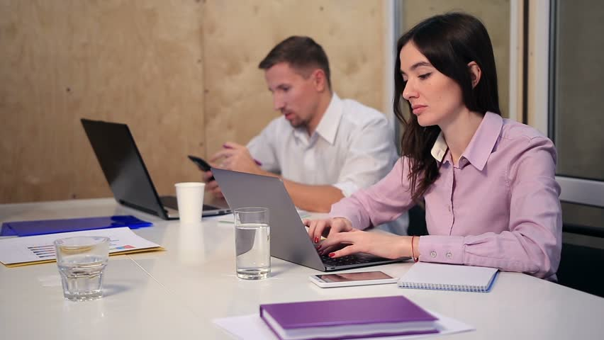 Business colleagues working at desk in the office | Shutterstock HD Video #22271902