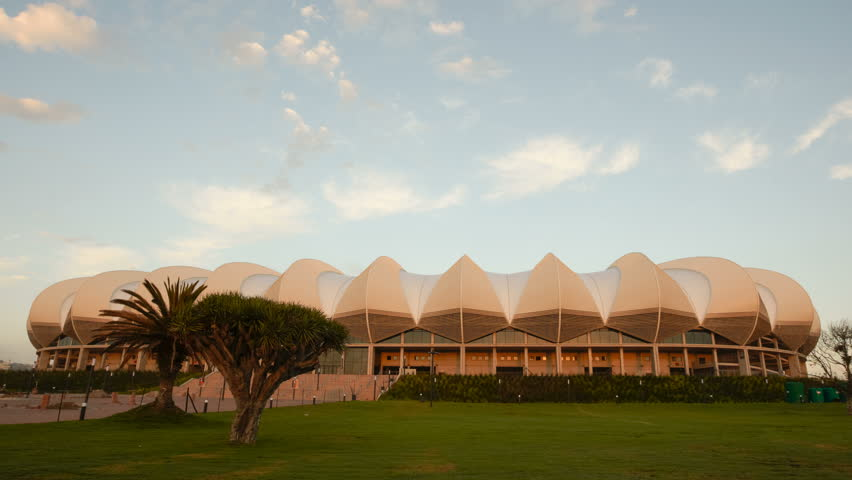 PORT ELIZABETH, SOUTH AFRICA - MAR 21, 2010: 4K Timelapse sunrise of the Nelson Mandela Bay Stadium. It was built to resemble the national flower of South Africa, a giant protea.
