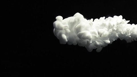 White paint cloud spraying on a black background.