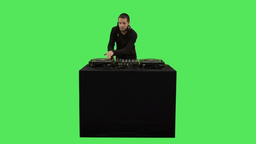 Male DJ playing music on turntable decks