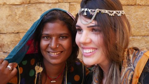 Tourist taking photos with Rajasthani traditional woman, Jaisalmer, India