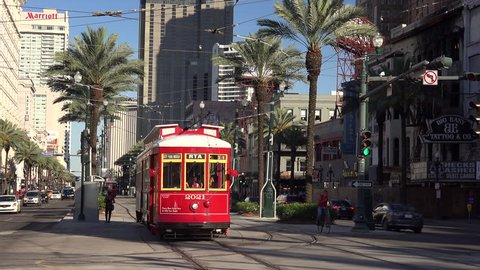NEW ORLEANS, LOUISIANA - MAY 6th: Traffic and Streetcars on Canal Street in downtown New Orleans, Louisiana on May 6th, 2016.