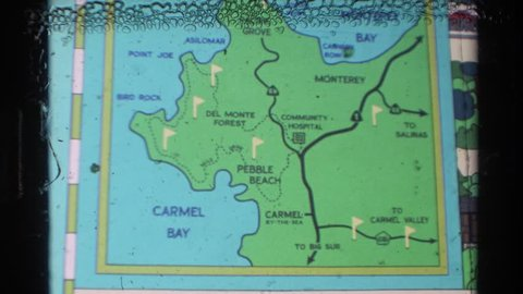 Carmel california 1982: a posted map on a board of carmel bay, pebble  beach, and directional to big sur
