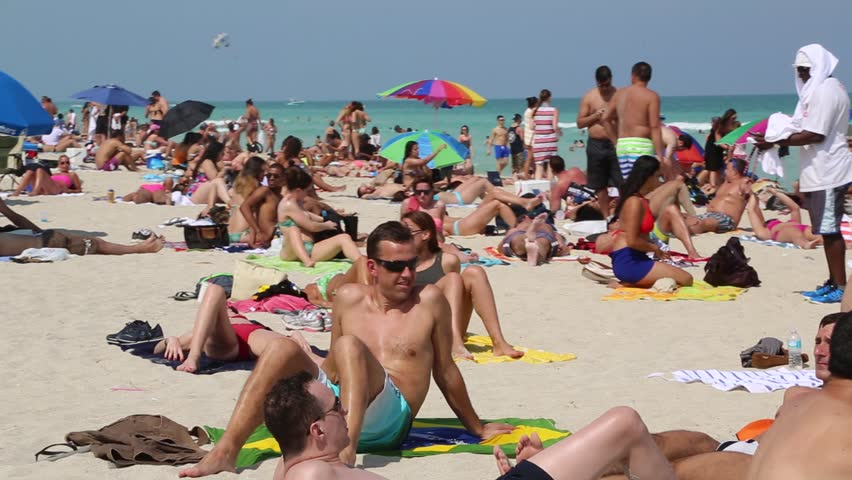 Miami Florida Circa 2016 A Group Of Male Female Sunbathers On The