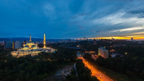Time lapse of The Federal Territory Mosque at sunrise: The mosque's design is a blend of Ottoman and Malay architectural styles, heavily influenced by the Blue Mosque in Istanbul, Turkey. 4K.