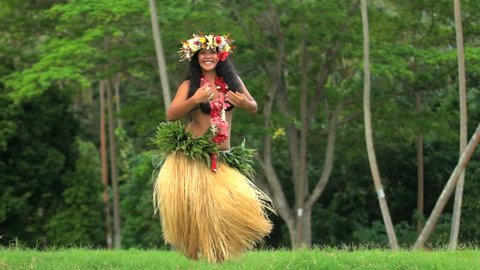 Young Polynesian Tahitian female hula dancer performing outdoor barefoot in traditional costume Tahiti French Polynesia South Pacific