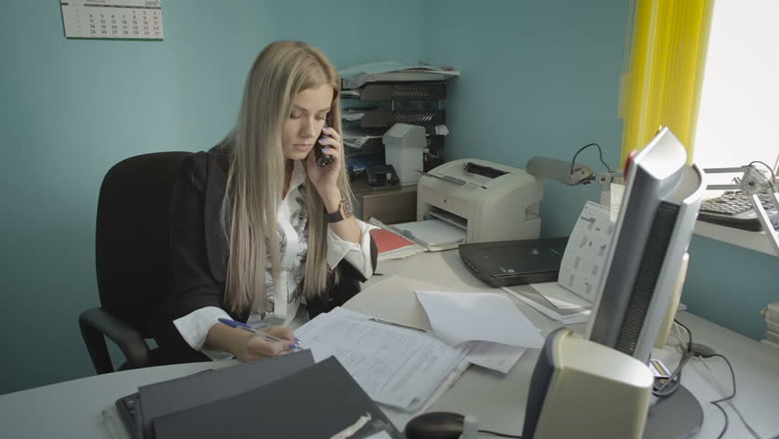 Beautiful young business woman talking on the phone in office stock footage video | Shutterstock HD Video #22511422