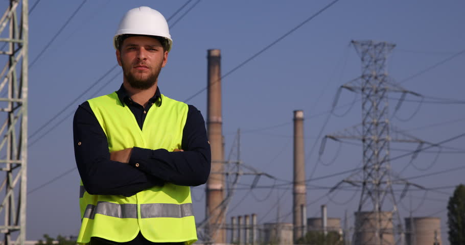 Proud Electricity Engineer Man Portrait Look Camera Power Plant Energy Industry. Ultra High Definition, UltraHD, Ultra HD, UHD, 4K, 2160P, 4096x2160 | Shutterstock HD Video #22520974