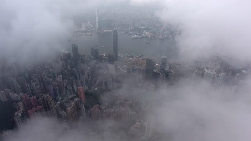 Panorama view of Hong Kong city in foggy morning, when all tall towers and skyscrapers with offices inside get in mist before rain, video can be used for advertising, promo and filmmaking industry