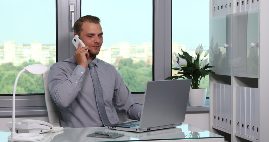 attractive business man talking cell phone collaboration team work office desk ultra high definition - How To Get Hired After Being Fired Or In Downtimes