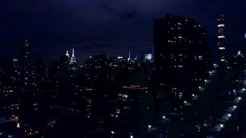 night view of Manhattan flying back over Queensboro Bridge