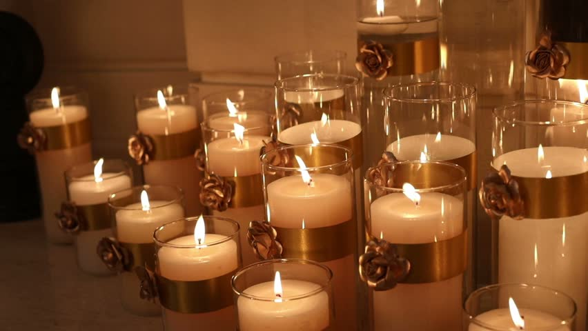 many candles burning decorative candle in a glass candlestick large wax candles are lit - Decorative Candles