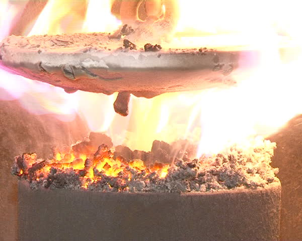 closeup of burning straw granules in boiler. flames and fire details. ecologic fuel use for house heating.