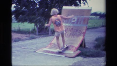 ALISO VIEJO CALIFORNIA 1976: kid skateboarding slow mo entertained