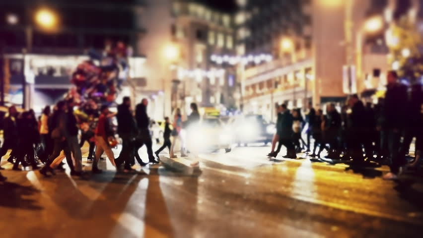 City pedestrians on winter night, cross street, slowmo 100p.Stabilized dolly shot of an anonymous crowd of pedestrians  crossing a busy intersection at night.No logos/faces visible.Commercial shot. #22618942