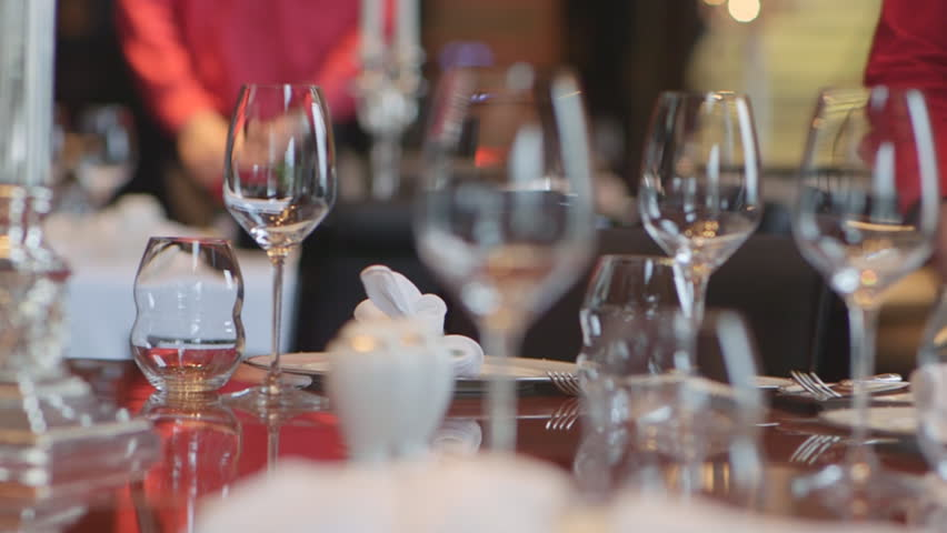 Waiters Serves A Table With Glass And Tableware For Banquet