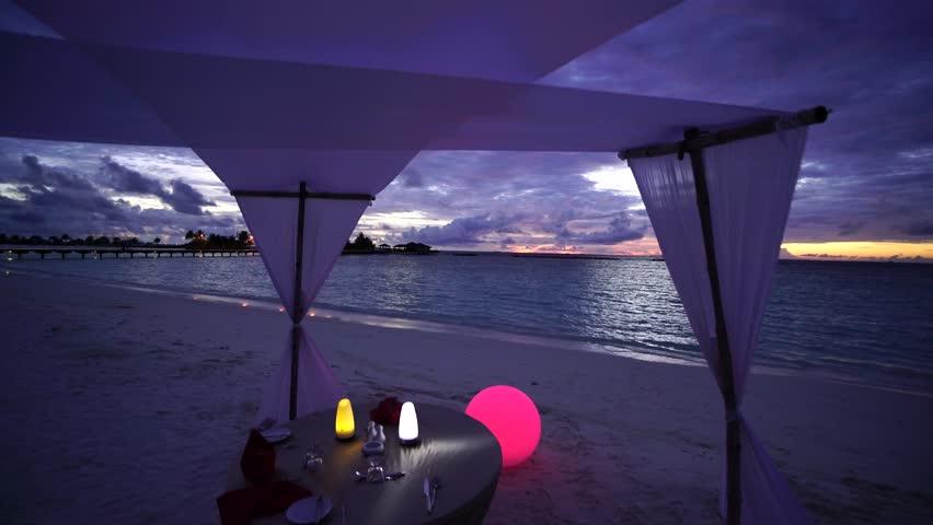 Sunset on Maldives island, water villas resort. Maldives 2015   Shutterstock HD Video #22647982