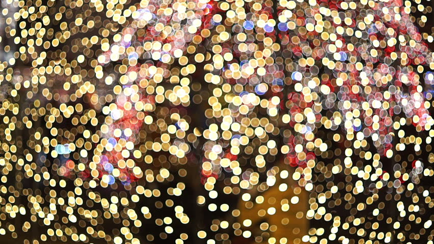 Abstract blurred bokeh blinking lights.  Christmas out of focus setting with silhouettes of people working in the background  | Shutterstock HD Video #22661182