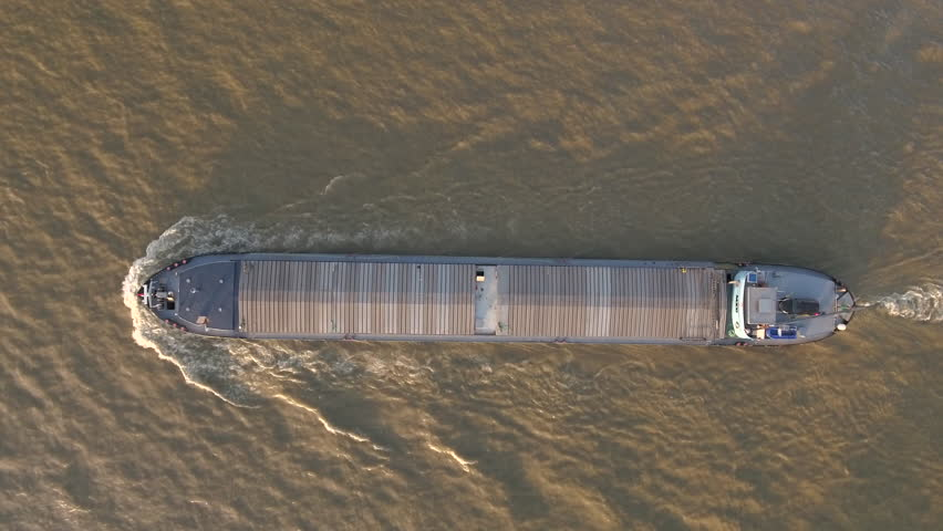 Aerial shot of barge cruising on the Danube river