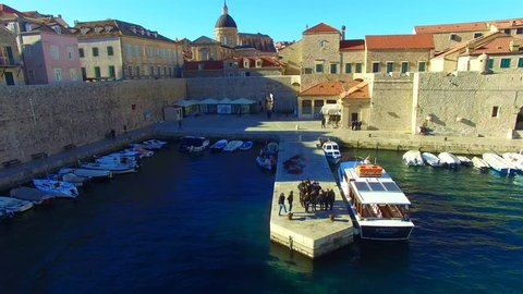 Dubrovnik: Aerial view of the city harbor in the old town of Dubrovnik in Croatia, Europe filmed by a drone 1/2