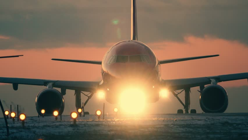 Plane preparing for takeoff at sunset. Airplane lights  backlit | Shutterstock HD Video #22773922