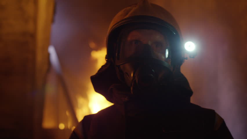 Building is on Fire. Brave Fireman Slowly Enter's the Room while Looking Around. Tongues of Flame are Licking Walls of the House. Shot on RED EPIC 4K (UHD).