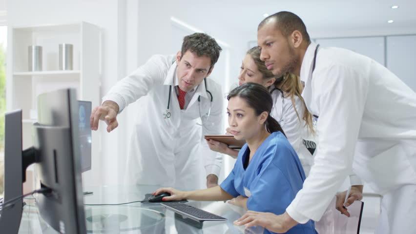 4K Medical team in modern hospital looking at computer & having a meeting Dec 2016-UK   Shutterstock HD Video #22821922