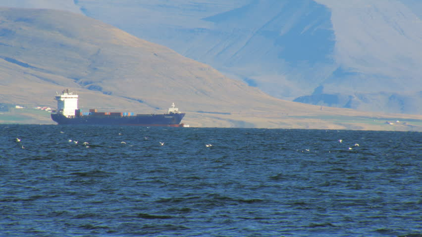 huge trawler in Atlantic ocean near coast of Reykjavik, mountain is on background, seagull flock #22850050