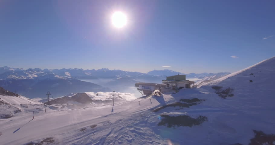 Flying over cable car terminal in Crans-Montana - Switzerland | Shutterstock HD Video #22921972