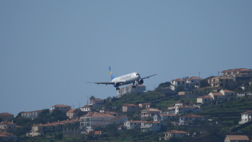 Airbus A 321 OY-VKT of Thomas Cook Discending to Madeira Airport. 4K UltraHD 2160p Airliner Video. Madeira Airport (Funchal, FNC, LPMA) is the civil airport of the Portuguese island of Madeira.