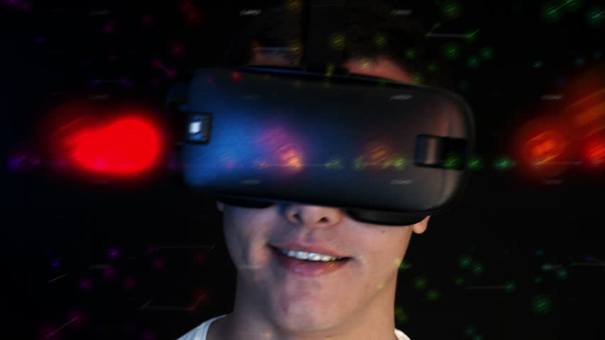 Smiling young man wearing VR Headset experiencing virtual reality. 3D objects flying around head. | Shutterstock HD Video #22943242
