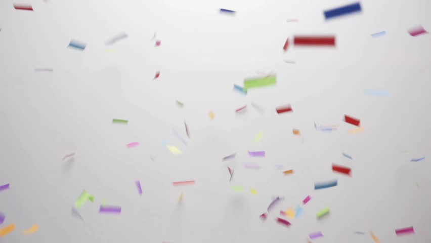 Party, decoration and holidays concept - confetti falling over white background | Shutterstock HD Video #22981282