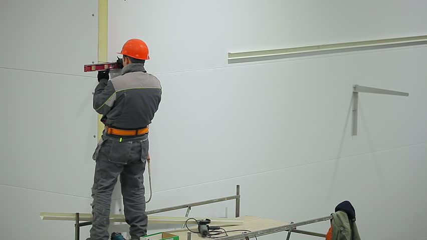 Marking the wall for laying the cable on the wall production facilities | Shutterstock HD Video #23005672