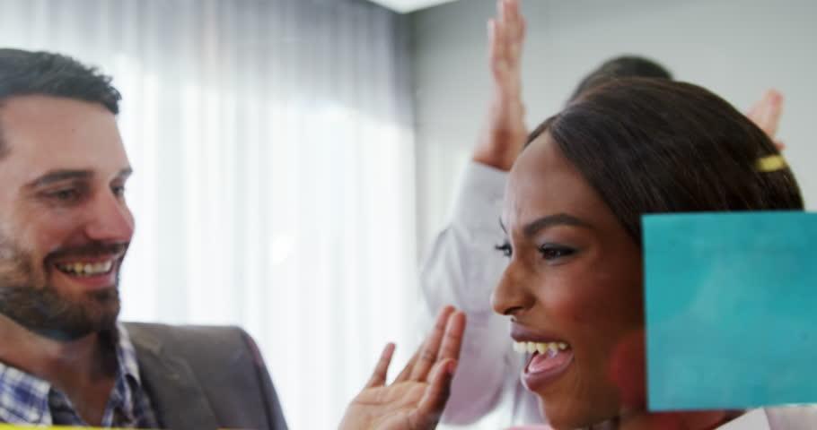 Businesspeople giving high five to each other in the office 4k | Shutterstock HD Video #23011102