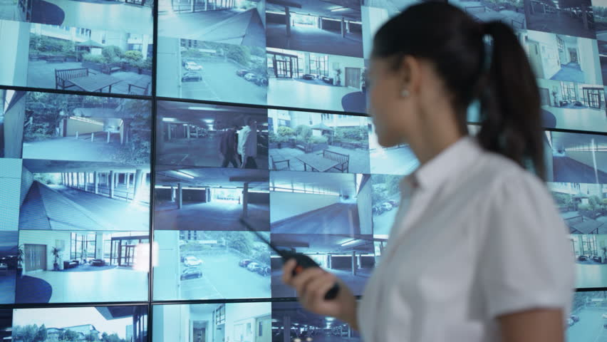 4K Security officer watching CCTV video screens & talking on radio Dec 2016-UK | Shutterstock HD Video #23017672