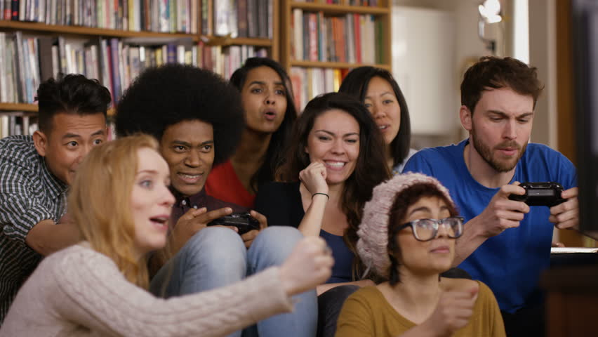4K Large group of happy young friends playing video games at home Dec 2016-UK | Shutterstock HD Video #23024542