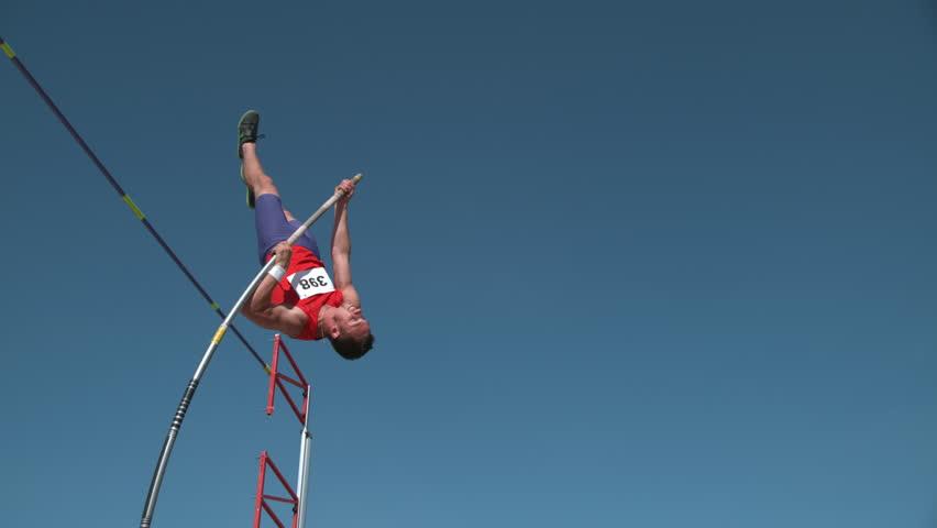 Track athlete doing pole vault in super slow motion, shot on Phantom Flex 4K