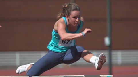 Track athlete jumps hurdle in super slow motion, shot on Phantom Flex 4K
