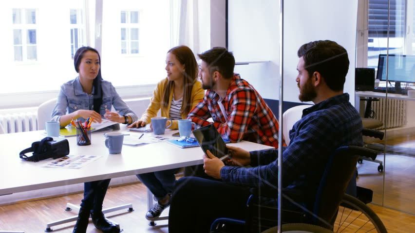 Graphic designers discussing over photographs in conference room | Shutterstock HD Video #23120122
